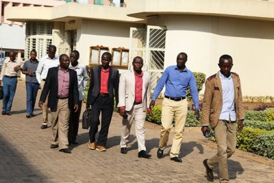 The nine Rwandans who were illegally deported from Uganda making their way to the Sub-Registry of the East African Court of Justice near the Supreme Court.