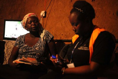 An enumerator collects details of a household during the census exercise in Nyalenda slums, Kisumu on August 24, 2019.
