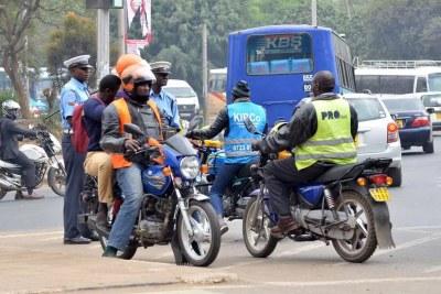 Boda Boda riders turn a roundabout to pick and drop passengers along Kenyatta Avenue in Nairobi.