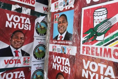 Posters calling for a vote for President Nyusi of Mozambique.
