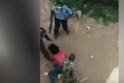 Screen shots from the viral video which captured uniformed policemen clobbering a student from Jomo Kenyatta University of Agriculture and Technology.
