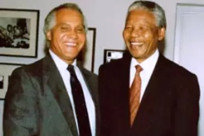 Africare co-founder Dr. Joseph C. Kennedy with South African President Nelson Mandela in 1994.