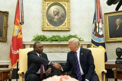 US President Donald Trump shakes hands with Kenyan counterpart Uhuru Kenyatta at the White House (file photo).