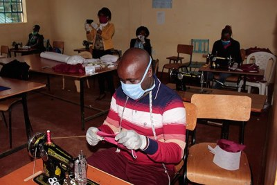Tailors sew masks at Mukiria Technical Training Institute.