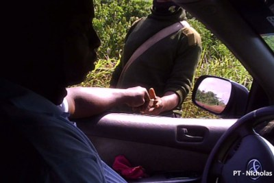 A Nigerian policeman collecting a bribe.