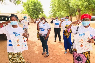 A group of girl advocates out in their community in Mali raising awareness about COVID-19