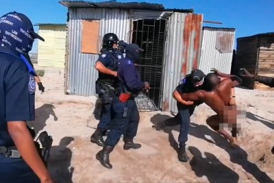 The City of Cape Town is investigating an incident in which a naked man was dragged from his shack during a demolition.