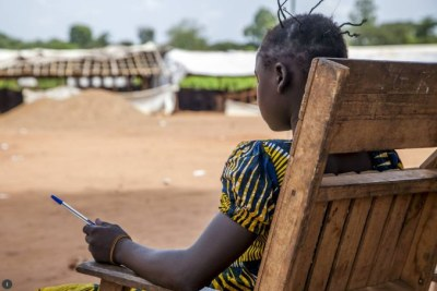 A girl sits outside her school building in Bambari, Central African Republic (file photo).