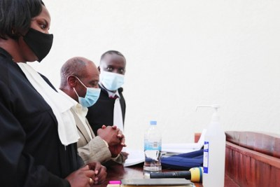 Paul Rusesabagina, centre, with his lawyers David Rugaza, right, and Emeline Nyembo during the pre-trial hearing at Kicukiro Primary Court on Monday, September 14.