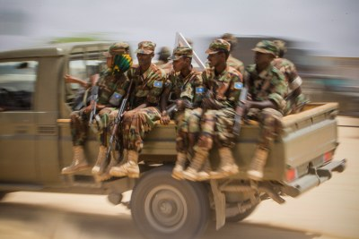 Members of the Somali National Army (SNA) at a passing-out parade on August 14, 2012, at an African Union Mission in Somalia (AMISOM) training facility on the western fringes of the Somali capital Mogadishu.