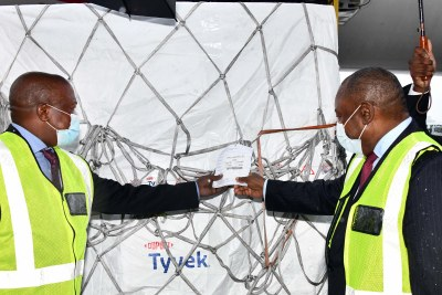 South African president Cyril Ramaphosa, right, and his deputy David Mabuza with the first batch of Covid-19 vaccine at OR Tambo International Airport in Johannesburg on February 1, 2021.