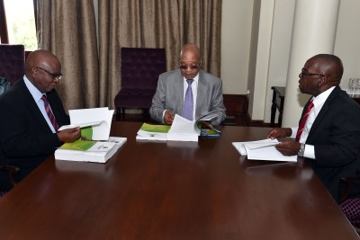 Former president Jacob Zuma receives the Arms Deal Report from Judges Willie Seriti and Thekiso Musi on December 30, 2015 .